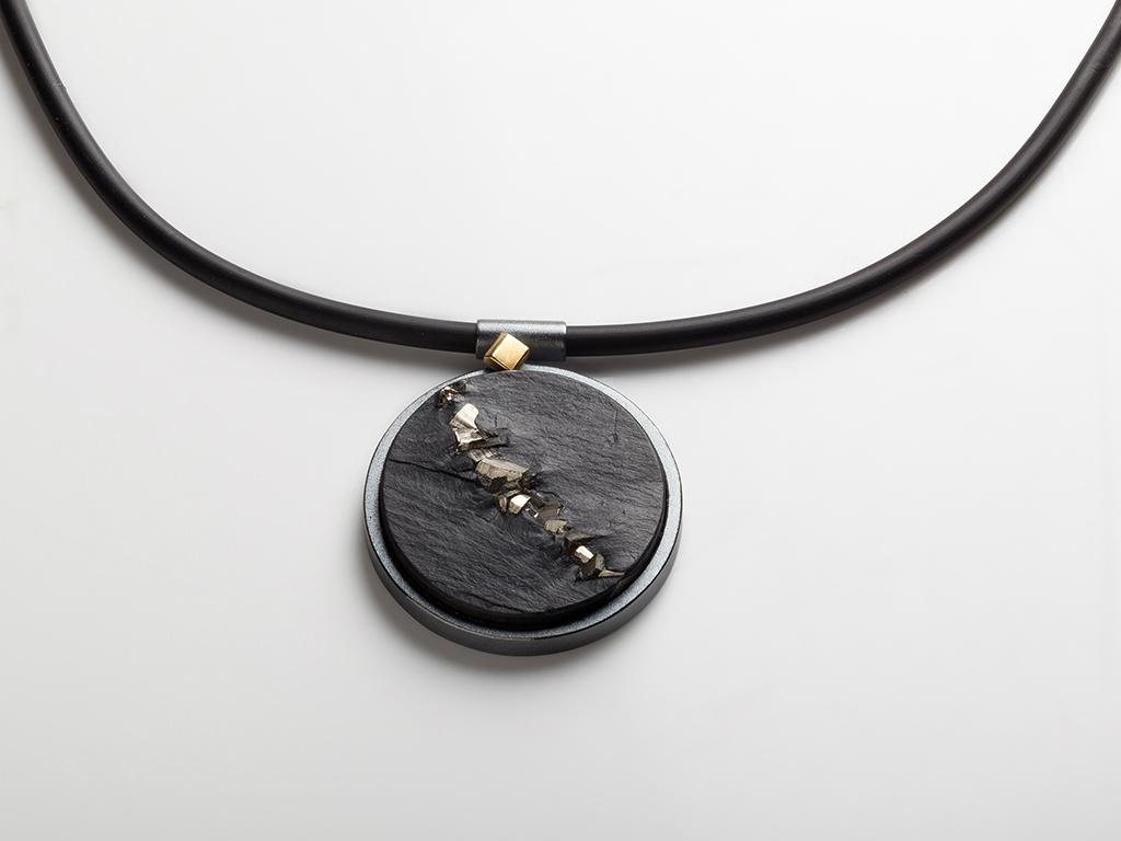 Pendant slate and pyrite, oxidized sterling silver , 18kt yellow gold on rubber cord